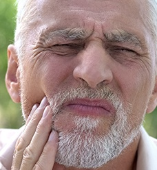 man with mouth pain
