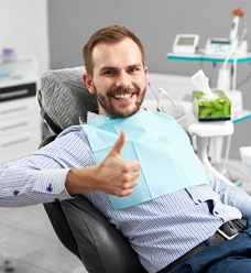 Patient at dentist thumbs up