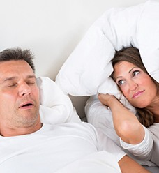Man snoring with partner unhappy