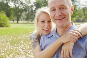 portrait of a couple embracing in the park