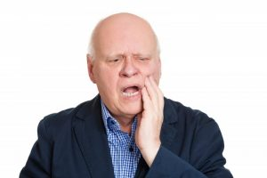 older man with denture problems