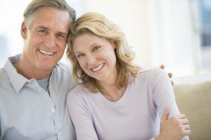 older couple smiling at home
