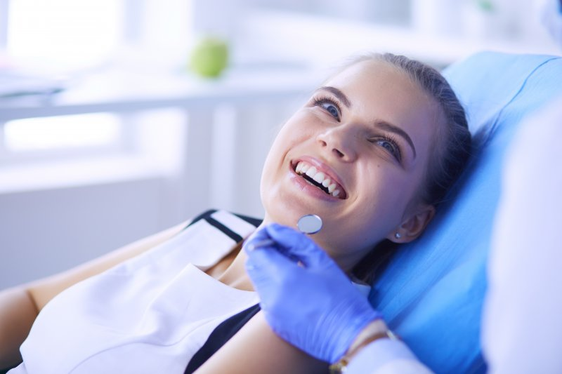 a young female patient smiling while visiting her dentist in Jacksonville